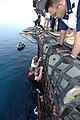 US Navy 050510-N-3241H-064 Sailors and Marines climb down a cargo net and into the cool waters of the Persian Gulf during a swim call aboard the Nimitz class aircraft carrier USS Carl Vinson (CVN 70).jpg