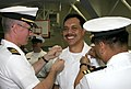 US Navy 050527-N-1113S-021 Senior Chief Petty Officer Reynaldo Ramos smile as his senior chief anchors are pinned on during a frocking ceremony on board Naval Air Facility Atsugi.jpg