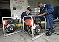 US Navy 050913-N-8933S-002 Damage Controlman 2nd Class Devon Williams and Hull Technician Paris Luh repair a P-100 Fire pump at the Medical Center of Louisiana Charity Hospital downtown New Orleans.jpg