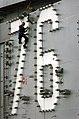 US Navy 051228-N-7130B-149 Electrician's Mate 3rd Class Brandon Wilkerson of Simms, Texas, change light bulbs on the island aboard the Nimitz-class aircraft carrier USS Ronald Reagan (CVN 76).jpg
