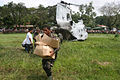 US Navy 060219-M-8084P-077 Members of the Philippine Army help U.S. Marines and Sailors, unload bottled water from a CH-46E Sea Knight helicopter.jpg