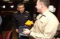US Navy 070316-N-9712C-004 USS Ronald Reagan (CVN 76) Commanding Officer, Capt. Terry Kraft hands a photo album to Japan Maritime Self Defense Force (JMSDF) Commander, Escort Flotilla Three (CCF3) Rear Adm. Yukitaka Miyazaki as.jpg
