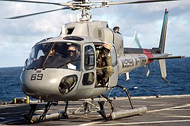 US Navy 070505-N-7029R-061 Crewmembers from a Brazilian navy helicopter prepare to take off from USS Pearl Harbor (LSD 52) during UNITAS exercises