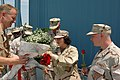 US Navy 070511-N-8724D-006 Engineman 2nd Class, Postal Clerk 3rd Class Dalyn Padilla and Gunner's Mate 1st Class Mark O'Kelley receive roses before their entry into Hanger Five on board Naval Air Station Atlanta.jpg