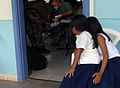 US Navy 070723-N-7088A-006 Two students from a local school watch as a fellow classmate receives dental care at the El Realejo Health Care Center, where medical personnel attached to Military Sealift Command (MSC) hospital ship.jpg