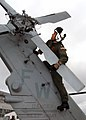 US Navy 070820-N-9860Y-028 Lt. Cmdr. Nelson Craig performs pre-flight checks on the tail rotor of a MH-60S Seahawk helicopter assigned to Naval Air Station Whidbey Island Search and Rescue (SAR).jpg