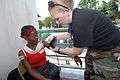 US Navy 070902-N-8704K-133 Senior Airman Erin Baker, attached to Military Sealift Command hospital ship USNS Comfort (T-AH 20), checks vital signs for Kerlande Deletable at Hopital De L'universite D'etat D'Haiti.jpg