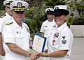 US Navy 070906-N-5411L-004 Vice Adm. Terrence Etnyre, commander of Naval Surface Forces, presents a Bronze Star to Cryptologic Technician (Technical) Kathryn Kunzmann of Pre-Commissioning Unit Makin Island (LHD 8).jpg