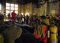 US Navy 071024-N-2638R-004 Sailors assigned to the submarine tender USS Frank Cable (AS 40), don fire fighting gear during an advanced shipboard fire fighting course at the Center for Naval Engineering's (CNE) Learning Site Yok.jpg
