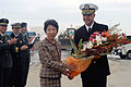 US Navy 071101-N-9123L-004 Cmdr. John S. Banigan, commanding officer of guided-missile destroyer USS John S. McCain (DDG 56), accepts flowers from the Sendai Welcoming Delegation.jpg