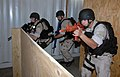 US Navy 071101-N-9758L-017 Sailors assigned to the guided missile cruiser USS Lake Erie (CG 70), tactically maneuvers through a passageway during a Non-Compliant Visit, Board, Search and Seizure drill.jpg