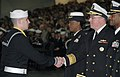 US Navy 080111-N-8848T-003 Vice. Adm. John C. Harvey Jr., Chief of Naval Personnel, shakes hands with Seaman Recruit Brock Michaud, from Newton, N.C., during graduation ceremonies at Recruit Training Command (RTC) at Naval Stat.jpg