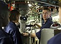 US Navy 080624-N-1841C-020 Lt. Matt Campell explains the operation of the periscope to a group of midshipmen embarked aboard the fast-attack submarine USS Newport News (SSN 750).jpg