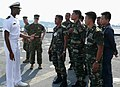 US Navy 080710-N-4431B-008 Ens. Marcus D. Fowler explains flight deck operations to Royal Malaysian air force, army, and navy officers.jpg