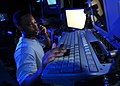 US Navy 080813-N-7981E-128 Operations Specialist 2nd Class Kindred Heard, from Loachapoka, Ala., communicates with the guided-missile destroyer USS Shoup (DDG 86).jpg
