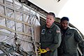 US Navy 080818-O-9999C-001 Aviation Support Equipment Technician 1st Class Glen Turner, right, and Aviation Structural Mechanic 3rd Class Jonathon Mack, both assigned to Fleet Logistic Support Squadron (VR) 46, load a pallet of.jpg