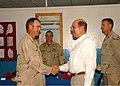 US Navy 080822-N-3560G-050 Secretary of the Navy congratulates Construction Electrician 1st Class James Harrison.jpg
