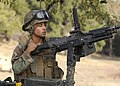 US Navy 081211-N-9584N-129 A Seabee assigned to Naval Mobile Construction Battalion (NMCB) 5 clears a jam to his M240B automatic weapon during a field training exercise at Fort Hunter Liggett.jpg