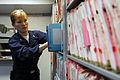 US Navy 090123-N-9760Z-004 Hospital Corpsman 2nd Class Jennifer Ross files medical records aboard the aircraft carrier USS Nimitz (CVN 68).jpg