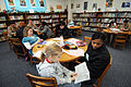 US Navy 090214-N-5328N-036 Information Systems Technician Seaman Aprentice Ashley Lumas, from New Orleans, listens as a West Pensacola Elementary School Saturday Scholar student reads out loud.jpg