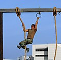 US Navy 090430-N-4301H-052 A first phase Basic Underwater Demolition-SEAL candidate grasps the rope on the rope transfer portion of the obstacle course at Naval Special Warfare Center at Naval Amphibious Base, Coronado.jpg