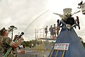 US Navy 090507-N-2468S-001 Cmdr. Bill Sloan, Chief Staff Officer of the 20th Seabee Readiness Group, aims a water hose at the finalist of the first-ever Naval Construction Battalion Center Gulfport Bee Wash.jpg