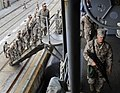 US Navy 090514-N-5345W-042 Marines assigned to the 22nd Marine Expeditionary Unit (22 MEU) board the amphibious dock landing ship USS Fort McHenry (LSD 43) during final preparations for deployment while pier side at Camp Lejeun.jpg