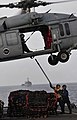 US Navy 091106-N-0807W-367 Boatswain's Mate 3rd Class Christopher L. Ellis, left, and Seaman Kayla L. Gravdal connect a hoisting sling to an MH-60S Sea Hawk helicopter aboard the amphibious dock landing ship USS Harpers Ferry (.jpg