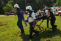 US Navy 100809-N-9180M-298 John Bianco, division chief of the Virginia Beach Police Department and Paramedic Richard Baker are assisted by Firefighter-Paramedic David Phelps and Firefighter Jason Piniol,.jpg
