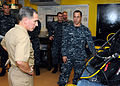 US Navy 101015-N-5620H-069 Rear Adm. Richard D. Berkey listens as Navy Diver 2nd Class Brian Elkins-Barkley explains the capabilities of the ship's.jpg
