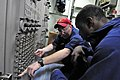 US Navy 110429-N-RC734-027 Interior Communications Electrician 2nd Class Zachariah Deaver, left, trains Electrician's Mate Fireman Jermichael McDuf.jpg
