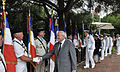 US Navy 110704-N-AG285-236 The mayor of Cannes, France, Bernard Brochand, shakes hands with official flag bearers during a memorial service honorin.jpg