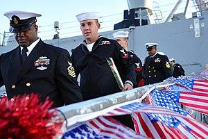 US Navy 111214-N-AW702-007 Sailors aboard the USS Samuel B. Roberts walk down the brow.jpg