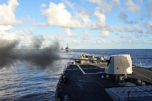 US Navy 120212-N-ED900-597 The MK 45 5-inch gun is fired aboard the guided-missile destroyer USS Pinckney (DDG 91) during a sea power demonstration.jpg