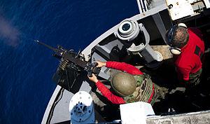 US Navy 120212-N-OY799-744 A Sailor fires a .50-caliber machine gun during a live-fire exercise aboard the Nimitz-class aircraft carrier USS John C.jpg