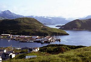 Unalaska Bay - The East Channel separates Unalaska Island, with the fishing boats berthed, from Amaknak Island. On the right side is Iliukliuk Harbor, the South Channel and Captains Bay in the background.