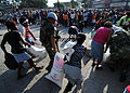 United Nations (UN) peacekeepers from Argentina provide security and assistance for women picking up 100-pound bags of rice for their families 100216-N-HX866-008.jpg