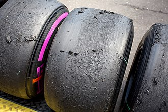 Racing slick - Pirelli ultra soft slick tyres seen at the 2016 Austrian Grand Prix. The tyre wear is clearly visible.