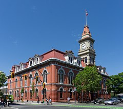Exterior view of red-brick Victoria City Hall with clock tower