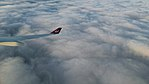 Virgin Atlantic Turning Above Clouds.jpg