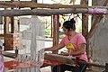 Weaving traditional Laotian garments (14602660931).jpg