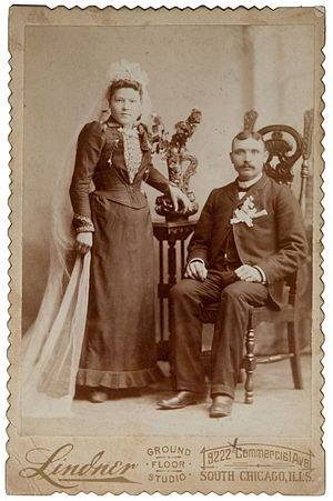 White wedding - A bride from the late 19th century wearing a black or dark coloured wedding dress