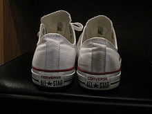 77359eeb1a28 A pair of white low-cut All Star sneakers