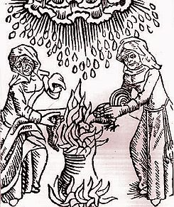 Witches add ingredients to a cauldron.JPG