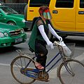 Woman is riding her bike.jpg