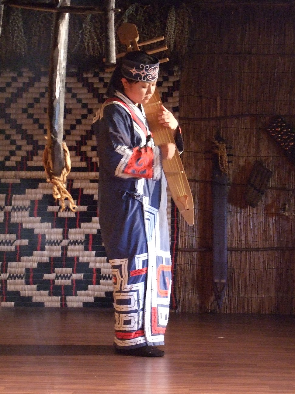Woman playing traditional Ainu instrument
