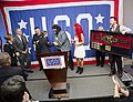 World Wrestling Entertainment wrestler Mick Foley, center right, congratulates U.S. Army Sgt. Sarah M. Deckert, center left, for winning the Enlisted Aide of the Year Award during the USO of Metropolitan 131113-D-HU462-142.jpg