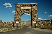 "The Roosevelt Arch is located in Montana at the North Entrance. The arch's cornerstone was laid by Theodore Roosevelt. The placard reads  ""For the Benefit and Enjoyment of the People."""