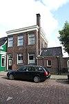 foto van Huis met verdieping en schilddak