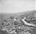 """Long shot, rocky fields, hills slated cottages spare trees"" is Lough Dan, County Wicklow (38054642226).jpg"
